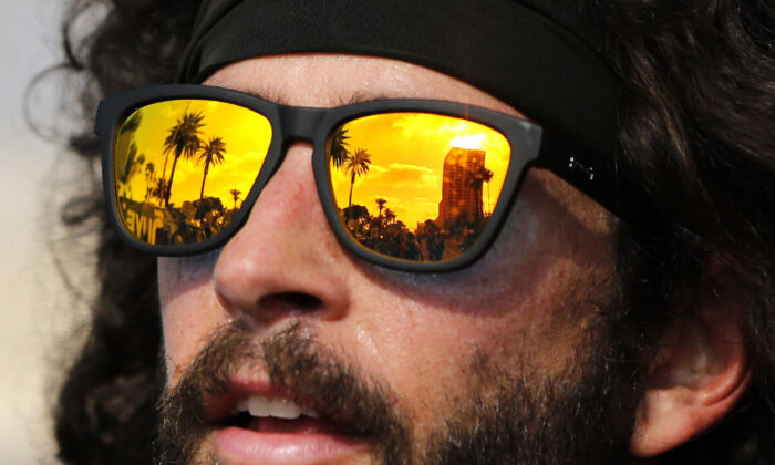 A reflection of palm trees in a runner's sunglasses following the finish of the 2019 Los Angeles Marathon  in Los Angeles on March 24, 2019. (Katharine Lotze/Getty Images)