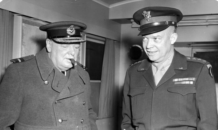 14th November 1944:  British Prime Minister Winston Churchill smokes a cigar and listens to Supreme Allied Commander Gen. Dwight D. Eisenhower speak during World War II. (Hulton Archive/Getty Images)