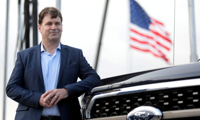 Ford Motor Co. CEO Jim Farley poses next to a new 2021 Ford F-150 pickup truck at the Rouge Complex in Dearborn, Mich., on Sept. 17, 2020. (Rebecca Cook/Reuters)
