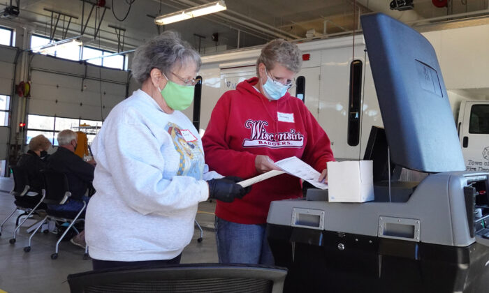 Election officials count absentee ballots at a polling place located in the Town of Beloit fire station near Beloit, Wisc. on Nov. 3, 2020. (Scott Olson/Getty Images)