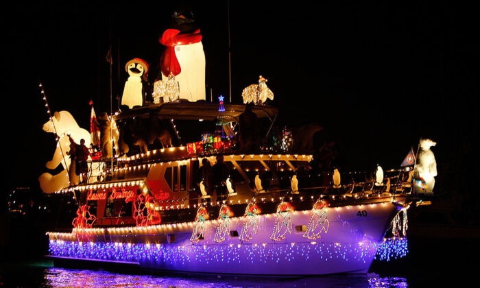 Boats in the 101st annual Newport Beach Christmas Boat Parade are lit with Christmas decorations as they move through through the night in Newport Beach, Calif., on Dec. 16, 2009. (David McNew/Getty Images)