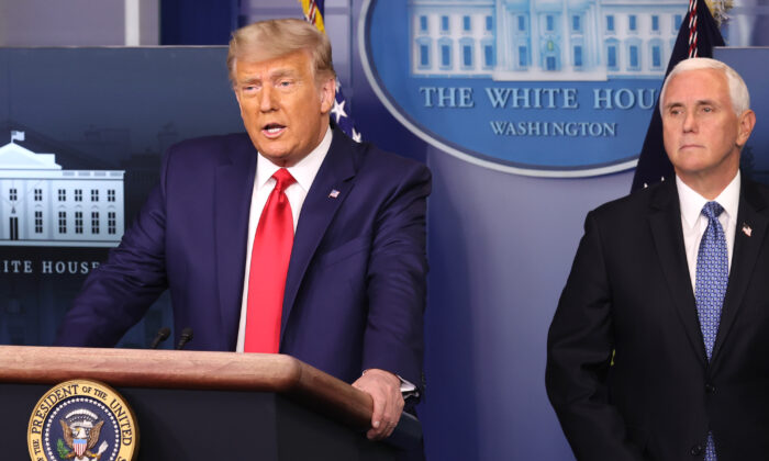 President Donald Trump (L) speaks as Vice President Mike Pence (R) looks on in the James Brady Press Briefing Room at the White House on Nov. 24, 2020. (Chip Somodevilla/Getty Images)