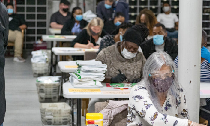Gwinnett County election workers handle ballots as part of the recount for the 2020 presidential election at the Beauty P. Baldwin Voter Registrations and Elections Building in Lawrenceville, Ga. on Nov. 16, 2020. (Megan Varner/Getty Images)