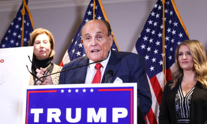 Trump lawyer and former New York City Mayor Rudy Giuliani speaks to media while flanked by lawyer Sidney Powell (L) and Trump campaign senior legal adviser Jenna Ellis at a press conference at the Republican National Committee headquarters in Washington on Nov 19, 2020. (Charlotte Cuthbertson/The Epoch Times)