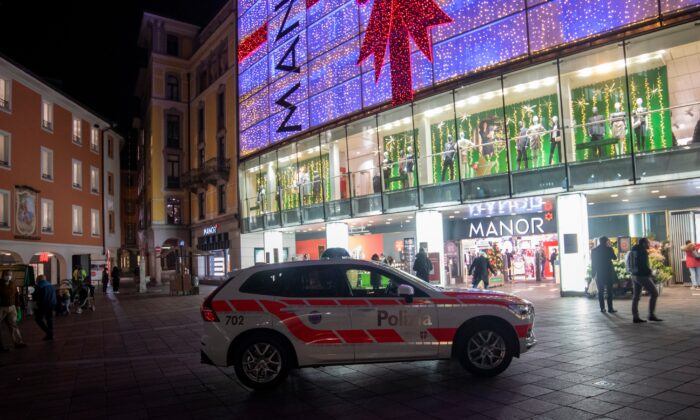 A police car in the area where a stabbing occurred in the department store, in Lugano, Switzerland, on Nov. 24, 2020. (Ti-Press/Keystone via AP)