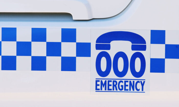 A general view of an emergency contact number on the side of a police car at Wagga Wagga Police Station on May 5, 2019 in Wagga Wagga, Australia. (Jenny Evans/Getty Images)