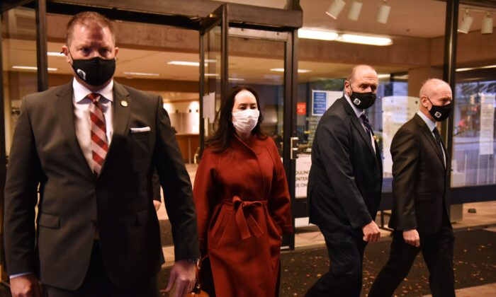 Huawei Chief Financial Officer, Meng Wanzhou, leaves British Columbia Supreme Court with her security team, in Vancouver, British Columbia, Canada, on Nov. 17, 2020. (Don Mackinnon/AFP via Getty Images)