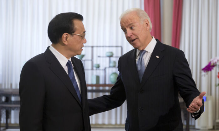 Former Vice President Joe Biden chats with Chinese Premier Li Keqiang at the Zhongnanhai diplomatic compound in Beijing, China on Dec. 5, 2013. (ANDY WONG/AFP via Getty Images)