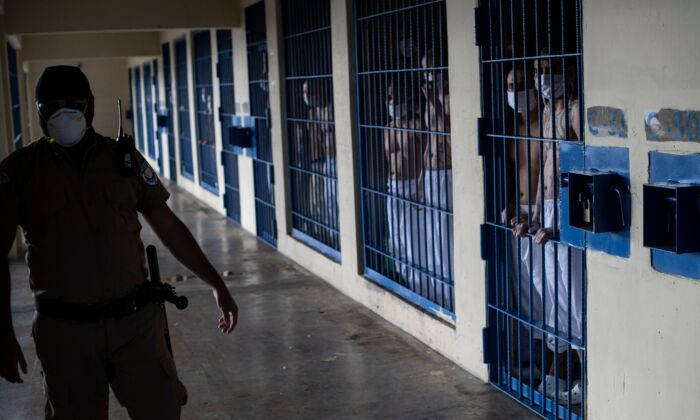 Members of the MS-13 and 18 gangs remain inside their cells at the maximum security prison in Izalco, Sonsonate, El Salvador, on Sept. 4, 2020. (Yuri Cortez/AFP via Getty Images)