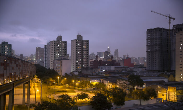 The Sao Paulo skyline is seen at dusk in Sao Paulo, Brazil, on June 21, 2014. (Oli Scarff/Getty Images)