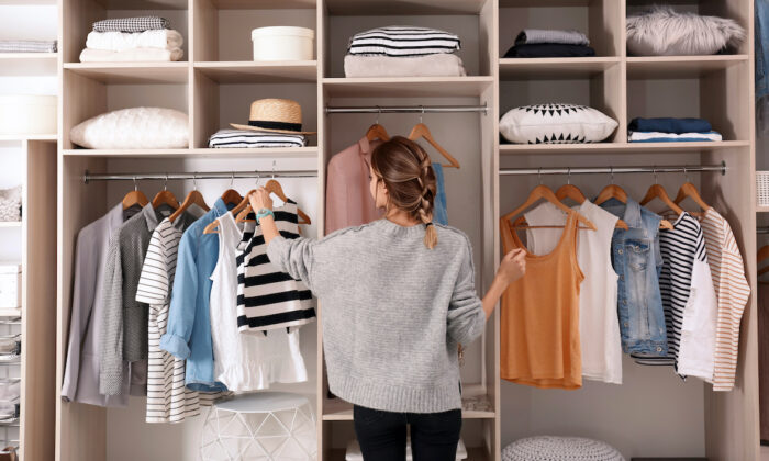 Organize your closet, and take inventory of what you have, before you keep buying more. (New Africa/Shutterstock)
