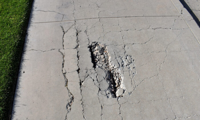 In addition to looking unattractive, a crumbling concrete sidewalk and driveway can be hazardous to walk on. (Sue A Dunning/Shutterstock)