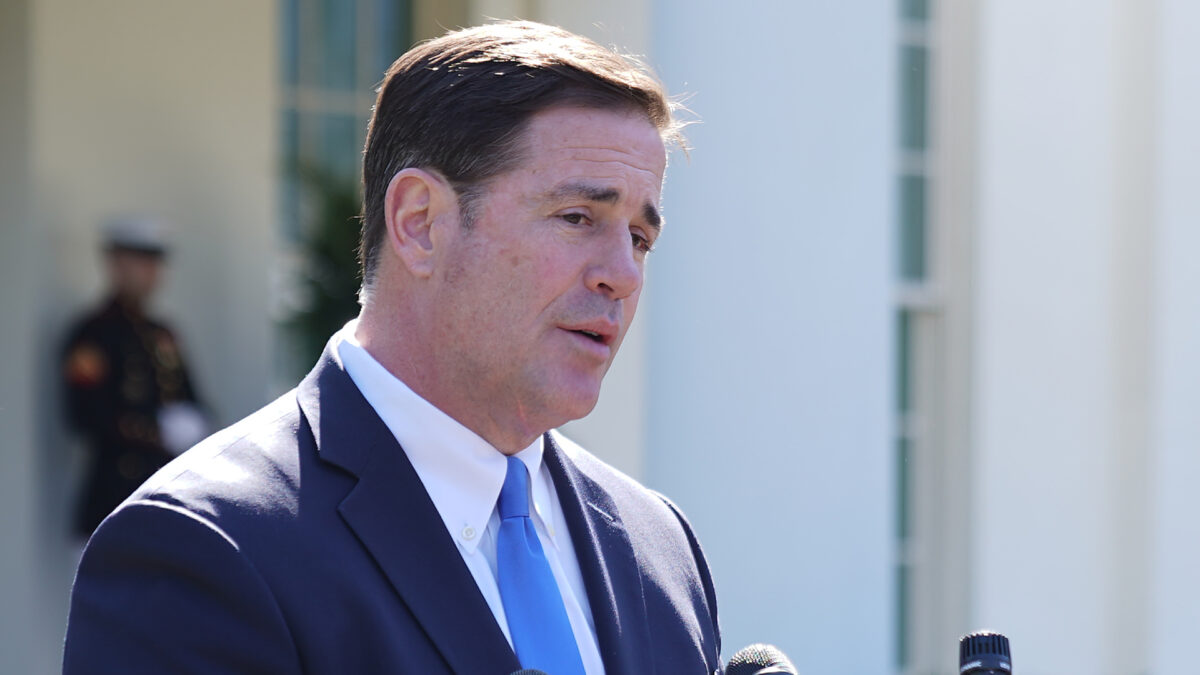Arizona Governor Doug Ducey talks to reporters