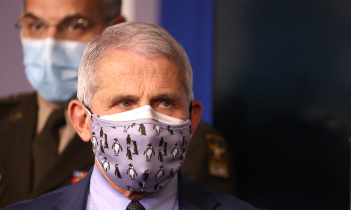 Dr. Anthony Fauci, director of the National Institute of Allergy and Infectious Diseases, walks inside the James Brady Press Briefing Room at the White House in Washington on Nov. 19, 2020. (Tasos Katopodis/Getty Images)