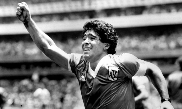 Argentinian star Diego Maradona raises his arm in the air after scoring his game winning goal against England in their World Cup semi final in Mexico on June 22, 1986. (Ted Blackbrow/Pool/File Photo/Reuters)