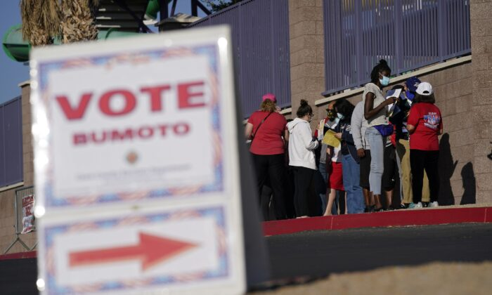 People wait in line to vote at a polling place on Election Day in Las Vegas, on Nov. 3, 2020. (John Locher/AP Photo)