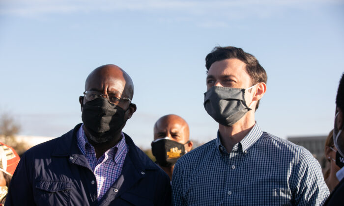 Democratic U.S. Senate candidates Jon Ossoff (R) and Raphael Warnock campaign in Marietta, Ga., on Nov. 15, 2020. (Jessica McGowan/Getty Images)