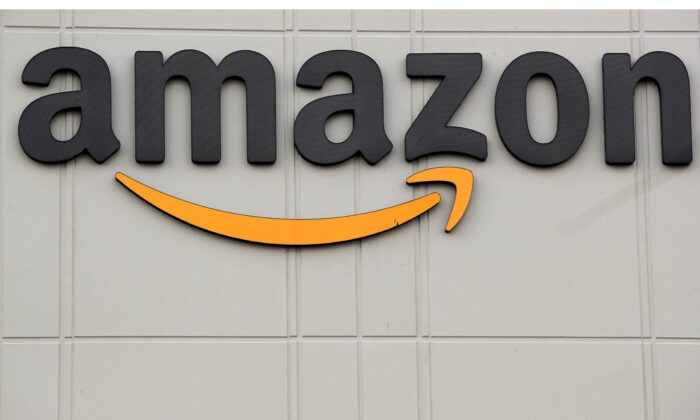 The Amazon logo is pictured outside the company's JFK8 distribution center in Staten Island, N.Y., on Nov. 25, 2020. (Brendan McDermid/Reuters)