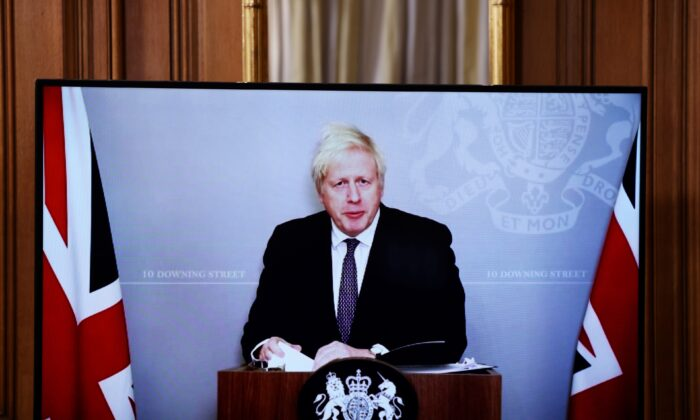 UK Prime Minister Boris Johnson attends (on screen) a virtual news conference on the ongoing situation with the CCP virus at Downing Street in London on Nov. 23, 2020. (Henry Nicholls/WPA Pool/Getty Images)