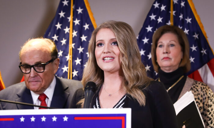 President Donald Trump campaign senior legal adviser Jenna Ellis speaks to media while flanked by Trump lawyer and former New York City Mayor Rudy Giuliani (L) and attorney Sidney Powell, at a press conference at the Republican National Committee headquarters in Washington on Nov. 19, 2020. (Charlotte Cuthbertson/The Epoch Times)