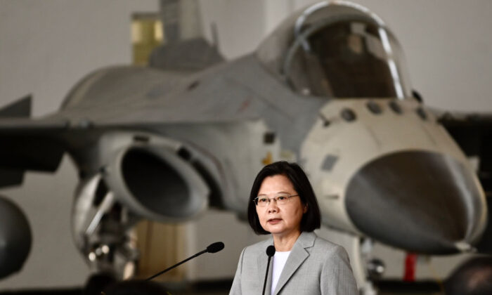 Taiwan's President Tsai Ing-wen speaks in front of a domestically produced F-CK-1 fighter jet in the Penghu islands, Taiwan,  on Sept. 22, 2020. (Sam Yeh/AFP via Getty Images)