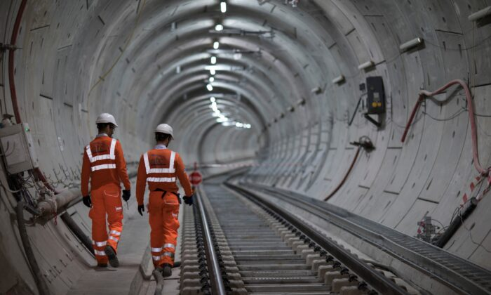 Crossrail engineers inspect the completed track as the Crossrail project celebrates the completion of the Elizabeth Line track, in London, on Sept. 14, 2017. (John Phillips/Getty Images)