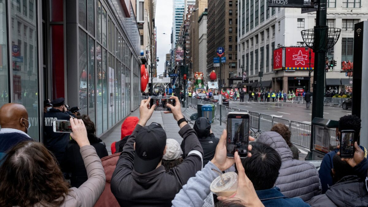People attempt to take photos