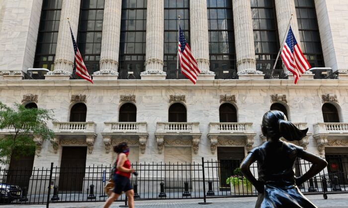 People pass by The New York Stock Exchange (NYSE) on Wall Street in New York City, on Aug. 3, 2020. (ANGELA WEISS/AFP via Getty Images)