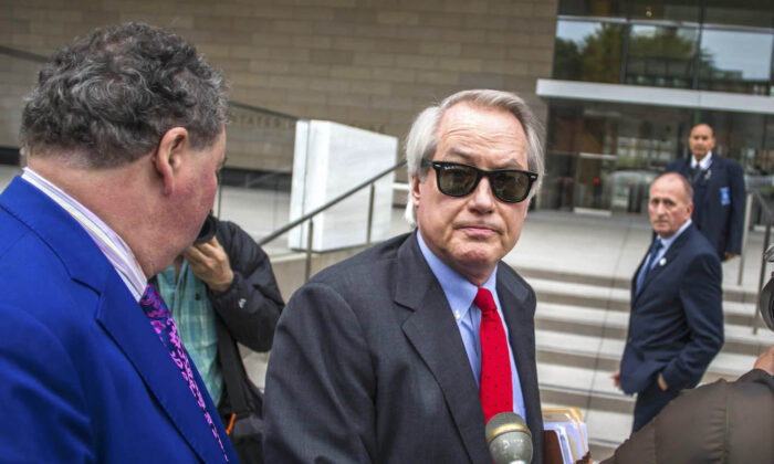 Lin Wood, center, at U.S. District Court, Central District of California in Los Angeles, Calif., on Dec. 3, 2019. (Apu Gomes/Getty Images)
