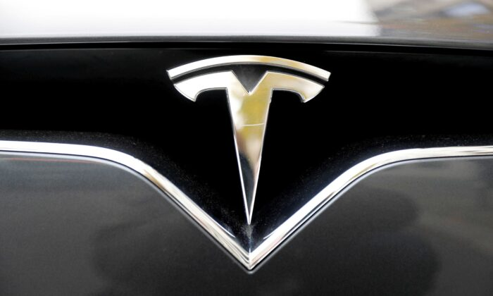 The company logo is pictured on a Tesla Model X electric car in Berlin, Germany, on Nov. 13, 2019. (Fabrizio Bensch/Reuters)