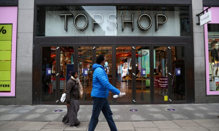 People walk past an entrance to the Topshop store at the Oxford Street, in London, on July 2, 2020. (Hannah McKay/File Photo/Reuters)