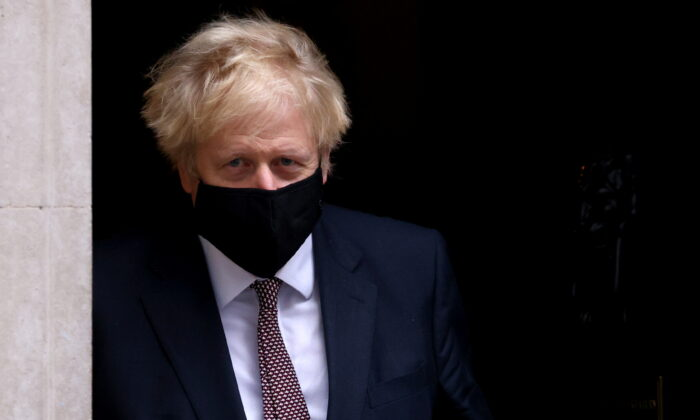 Britain's Prime Minister Boris Johnson seen in public for the first time since his self-isolation ended, leaves Downing Street during the CCP virus outbreak in London, UK, on Nov. 26, 2020. (Simon Dawson/Reuters)