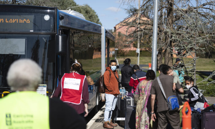 Passengers arrive at East Hotel after disembarking their flight from Delhi to Canberra, Australia on May 15, 2020. (Rohan Thomson/Getty Images)