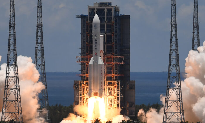 A Long March-5 rocket, carrying an orbiter, lander and rover as part of the Tianwen-1 mission to Mars, lifts off from the Wenchang Spacecraft Launch Center, in China's Hainan Province, on July 23, 2020. (Noel Celis/AFP via Getty Images)