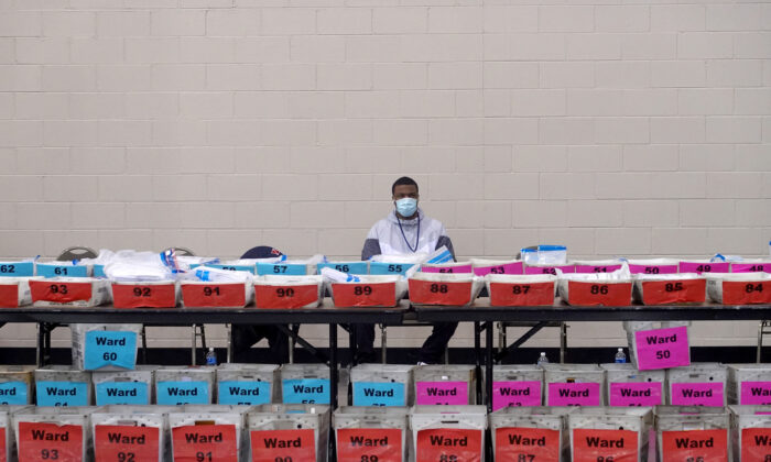 Election officials wait as procedural issues are argued during the process of recounting ballots from the Nov. 3 election at the Wisconsin Center in Milwaukee, Wis., on Nov. 20, 2020. (Scott Olson/Getty Images)