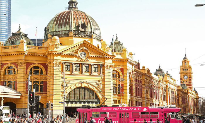 A tram passes in front of Flinders Street Railway Station on August 18, 2016 in Melbourne, Australia.   (Scott Barbour/Getty Images)