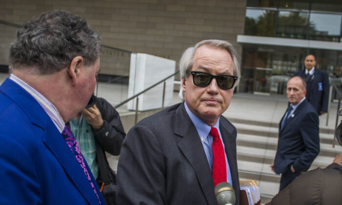 Attorneys L. Lin Wood (C) and Mark Stephen (L) speak to the media about their client, British rescue diver Vernon Unsworth (rear), as they arrive at U.S. District Court in Los Angeles, Calif. on Dec. 3, 2019. (Apu Gomes/Getty Images)