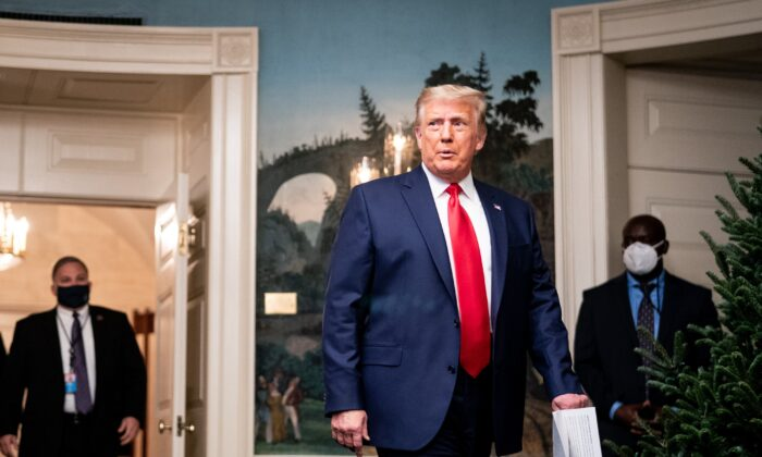 President Donald Trump arrives to speak in the Diplomatic Room of the White House in Washington, on Nov. 26, 2020. (Erin Schaff - Pool/Getty Images)
