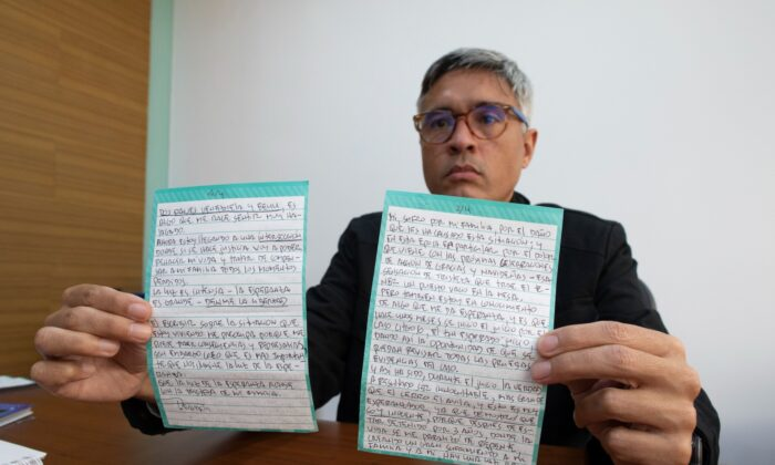 Jesus Loreto, an attorney representing Tomeu Vadell, one of six U.S. oil executives jailed for three years in Venezuela, shows a letter written by Vadell, in Caracas, Venezuela, on Nov. 25, 2020. (Ariana Cubillos/AP Photo)