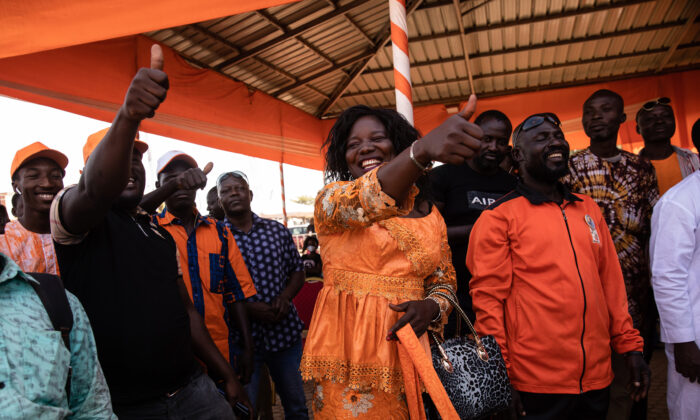 Supporters of President Roch Marc Christian Kabore celebrate in Ouagadougou as they learn he will serve another five years as Burkina Faso's president, according to provisional results announced by the National Independent Electoral Commission on Nov 26, 2020. (AP Photo/Sophie Garcia)