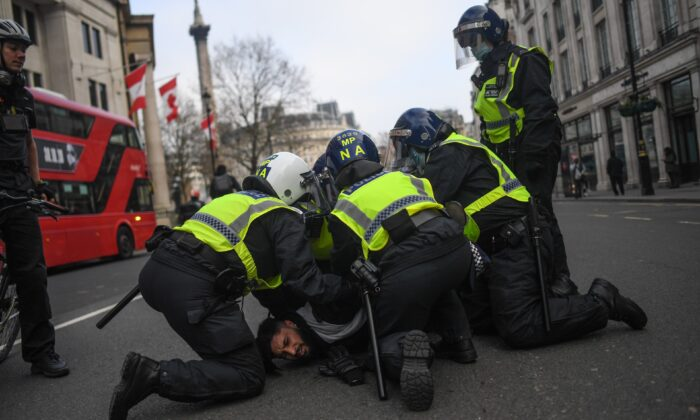 A man is seen being restrained by police during a protest in London, on Nov. 28, 2020. (Peter Summers/Getty Images)