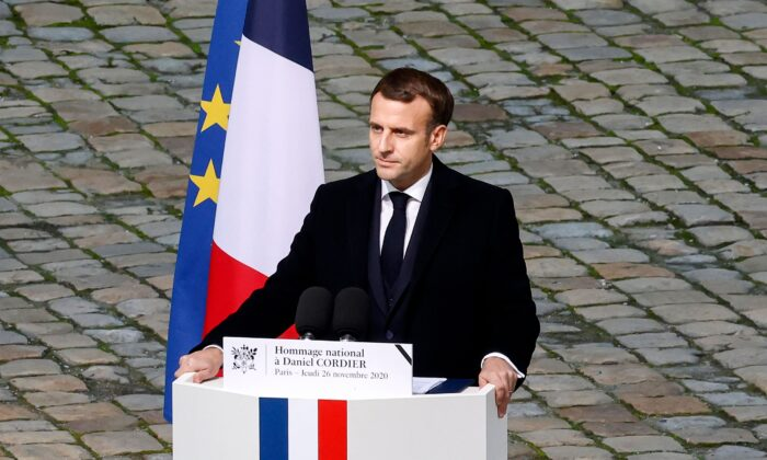 "French President Emmanuel Macron delivers a speech during an honorary funeral ceremony for World War II resistant and ""Compagnon de la Liberation"" Daniel Cordier at the Hotel des Invalides in Paris on Nov. 26, 2020. (Ludovic Marin/AFP via Getty Images)"