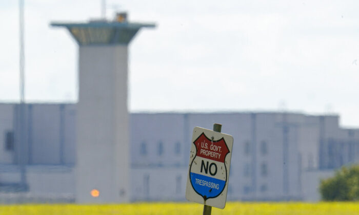 A No Trespassing sign stands in front the federal prison complex in Terre Haute, Ind., on Aug. 26, 2020. (Michael Conroy/AP Photo)