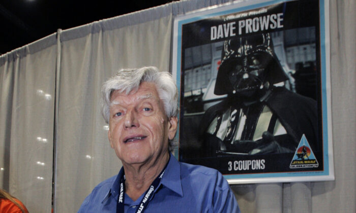 Actor David Prowse, who was the man in the black Darth Vader suit in the first Star Wars film, signs autographs at Star Wars Celebration IV, marking the 30th anniversary of the release of the first film in the Star Wars saga, in Los Angeles, on May 26, 2007. (Reed Saxon/AP Photo)
