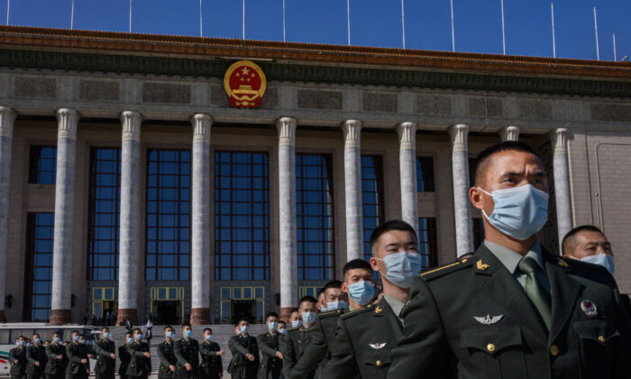 Soldiers with the People's Liberation Army march after a ceremony marking the 70th anniversary of China's entry into the Korean War, at the Great Hall of the People in Beijing on Oct. 23, 2020. (Kevin Frayer/Getty Images)