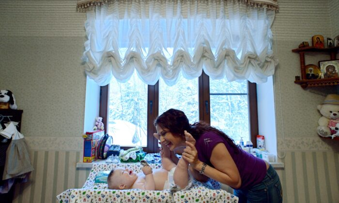 Russian actress Evelina Bledans plays with her son Semoyn, a child with Down syndrome, in their country house outside Moscow, on Feb. 8, 2013. (Kirill Kudryavtsev/AFP via Getty Images)