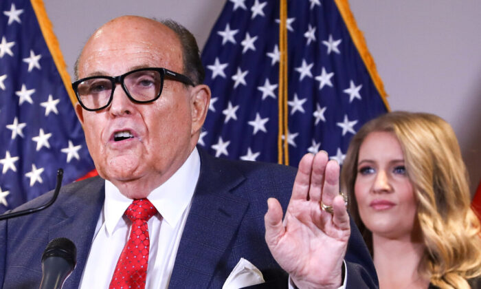 President Donald Trump lawyer and former New York City Mayor Rudy Giuliani speaks to media while flanked by Trump campaign senior legal adviser Jenna Ellis (R) at a press conference at the Republican National Committee headquarters in Washington on Nov. 19, 2020. (Charlotte Cuthbertson/The Epoch Times)