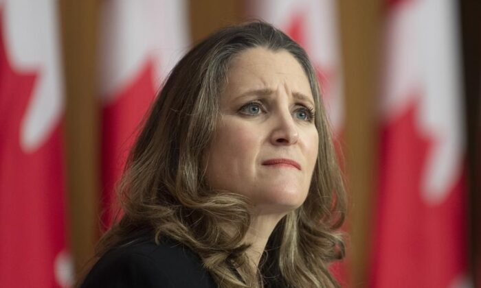 Deputy Prime Minister and Minister of Finance Chrystia Freeland listens to a question from a reporter on the phone during a news conference in Ottawa on Nov.  30, 2020. (The Canadian Press/Adrian Wyld)
