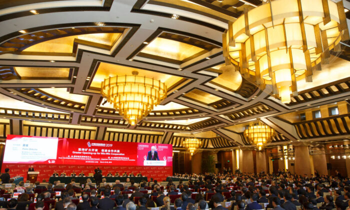 People attend the China Development Forum in Beijing on March 24, 2019. (Thomas Peter-Pool/Getty Images)