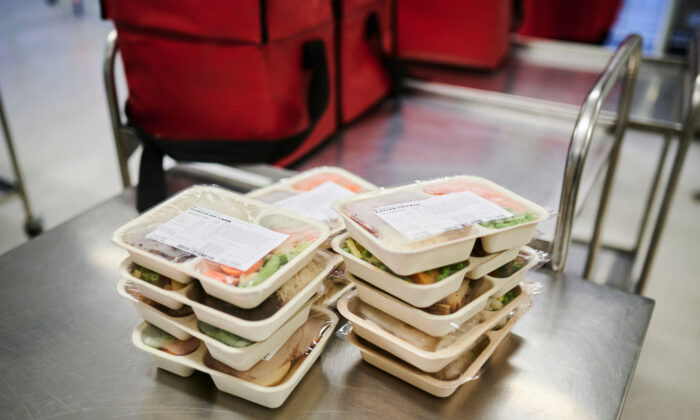 Frozen meals are packed for delivery at the Meals on Wheels Canberra headquarters on June 22, 2020 in Canberra, Australia. (Rohan Thomson/Getty Images)